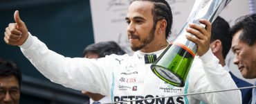 Lewis Hamilton celebrates winning the 1000th grand prix